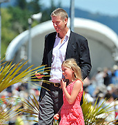 Hamilton, NEW ZEALAND. Australian Multi medalist, James [Jimmy} TOMKINS,  after receiving the KELLER medal, leaves the awards dock with his daughter.  2010 World Rowing Championships, Lake Karapiro. Saturday 06.11.2010.  [Mandatory Credit Peter Spurrier:Intersport Images].