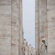 A detail of the center of the twin white pylons  of the Canadian National Vimy Memorial showing the Spirit of Sacrifice,and the Weeping Woman or Mother Canada mourning her dead. The monument is dedicated to the memory of Canadian Expeditionary Force members killed in World War one. The monument is situated at a 100 hectare preserved battlefield with wartime tunnels, trenches, craters and unexploded munitions. The memorial designed by Walter Seymour Allward opened in 1936.