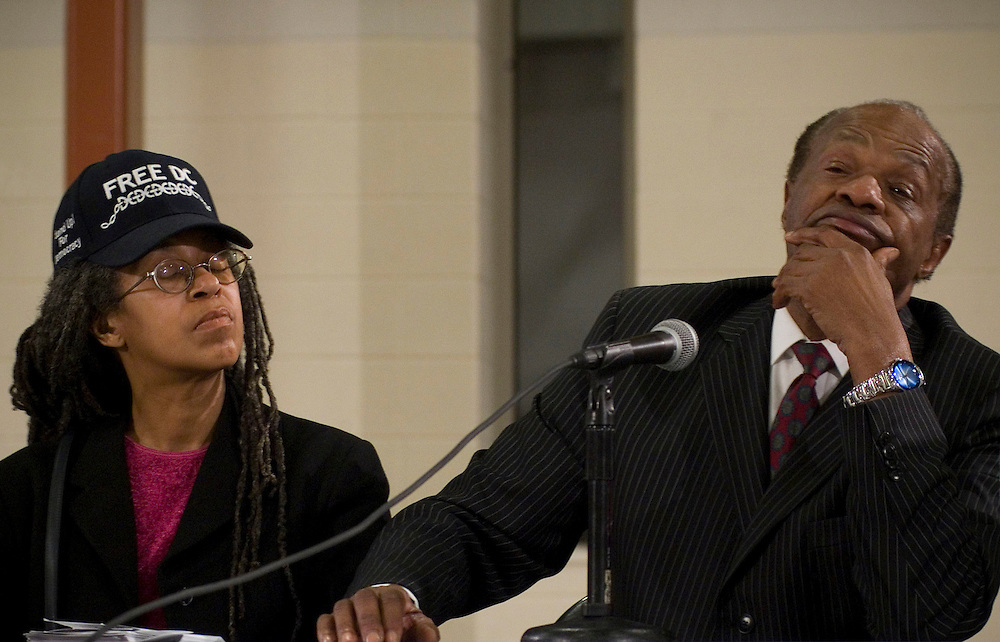 A LONG MEETING.Former Mayor/City Councilman Marion Barry, right, and President of Standup for Democracy Anise Jenkins listen to comments during a late evening town hall meeting in Washington, D.C., that concerns poverty in America during a 2007 Initiative conducted by Martin Luther King, III and his nonprofit organization, Realizing the Dream.