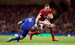 Wales' George North attempts to evade the tackle from Italy's Abraham Jurgen Steyn during the Guinness Six Nations match at the Principality Stadium, Cardiff.