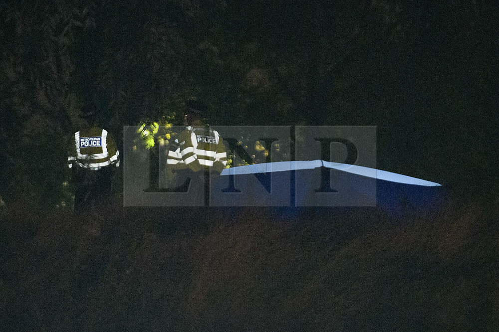 © Licensed to London News Pictures. 19/09/2021. London, UK. Police officers maintain a scene watch near a forensic tent in Cator Park on Kidbrooke Park Road in Greenwich following a call at 17:32BST on Saturday 18/09/2021 to the body of a female found near the community centre. A man was arrested several hours later at approximately 21:20BST at an address in Lewisham on suspicion of murder and was taken into custody at a south London police station. Photo credit: Peter Manning/LNP