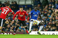 Oumar Niasse of Everton shields the ball from Marcos Rojo of Manchester United. Premier league match, Everton v Manchester Utd at Goodison Park in Liverpool, Merseyside on New Years Day, Monday 1st January 2018.<br /> pic by Chris Stading, Andrew Orchard sports photography.