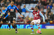 Leandro Bacuna of Aston Villa (R) in action with Lewis Grabban of Bournemouth.<br /> Barclays Premier League match, Aston Villa v AFC Bournemouth at Villa Park in Birmingham, The Midlands on Saturday 09th April 2016.<br /> Pic by Ian Smith, Andrew Orchard Sports Photography.