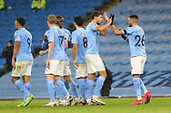 GOAL 5-0 Manchester City midfielder Riyad Mahrez (26) scores a goal and celebrates his Patrick during the Premier League match between Manchester City and Burnley at the Etihad Stadium, Manchester, England on 28 November 2020.