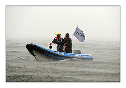 470 Class European Championships Largs - Day 1.Racing in grey and variable conditions on the Clyde..Wet Jury Boat