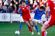 Accrington Stanley midfielder Dan Barlaser (26), on loan from Newcastle United,  shields the ball during the EFL Sky Bet League 1 match between Accrington Stanley and Portsmouth at the Fraser Eagle Stadium, Accrington, England on 27 October 2018.