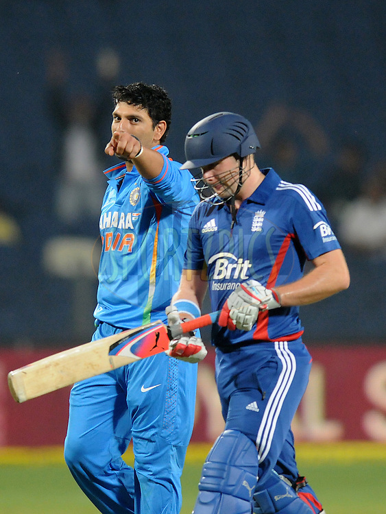 Yuvraj Singh of India reacts after claiming the wicket of Luke Wright of England during the first Airtel T20 Match between India and England held at Subrata Roy Sahara stadium in Pune on the  20th December 2012..Photo by  Pal Pillai/BCCI/SPORTZPICS .