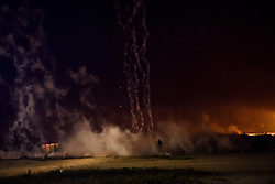 © Licensed to London News Pictures. 23/10/2016. Calais, France. French police fire tear gas at groups of migrants as they approach the motorway near the 'Jungle' camp in Calais, on the eve of the demolition of the camp. French authorities have given an eviction order to thousands of refugees and migrants living at the makeshift living area of the French coast. Photo credit: Ben Cawthra/LNP