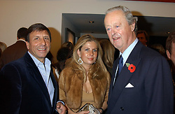 Left to right, the HON.SIR ROCCO FORTE, LADY FORTE and The DUKE OF MARLBOROUGH at a private view of paintings by Rosita Marlborough (The Duchess of Marlborough) held at Hamiltons gallery, Carlos Place, London W1 on 9th November 2005.<br />