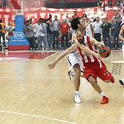 Olympiacos's Vassilis Spanoulis (F) and Anadolu Efes's Kerem Gonlum (C) during their Turkish Airlines Euroleague Basketball playoffs Game 5 Olympiacos between Anadolu Efes at SEF Indoor Hall in Piraeus, in Greece, Friday, April 26, 2013. Photo by TURKPIX