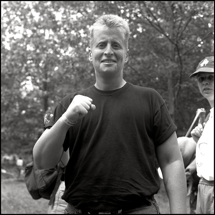 """Leslie Feinberg photographed at the Michigan Womyn's Music Festival in August of 1994. Feinberg came onto """"The Land"""" from Camp Trans for a workshop. Camp Trans, was an annual protest event held concurrently with Michfest that operated adjacent to the festival venue in response to the womyn-born womyn policy which constituted discrimination against transgender people."""