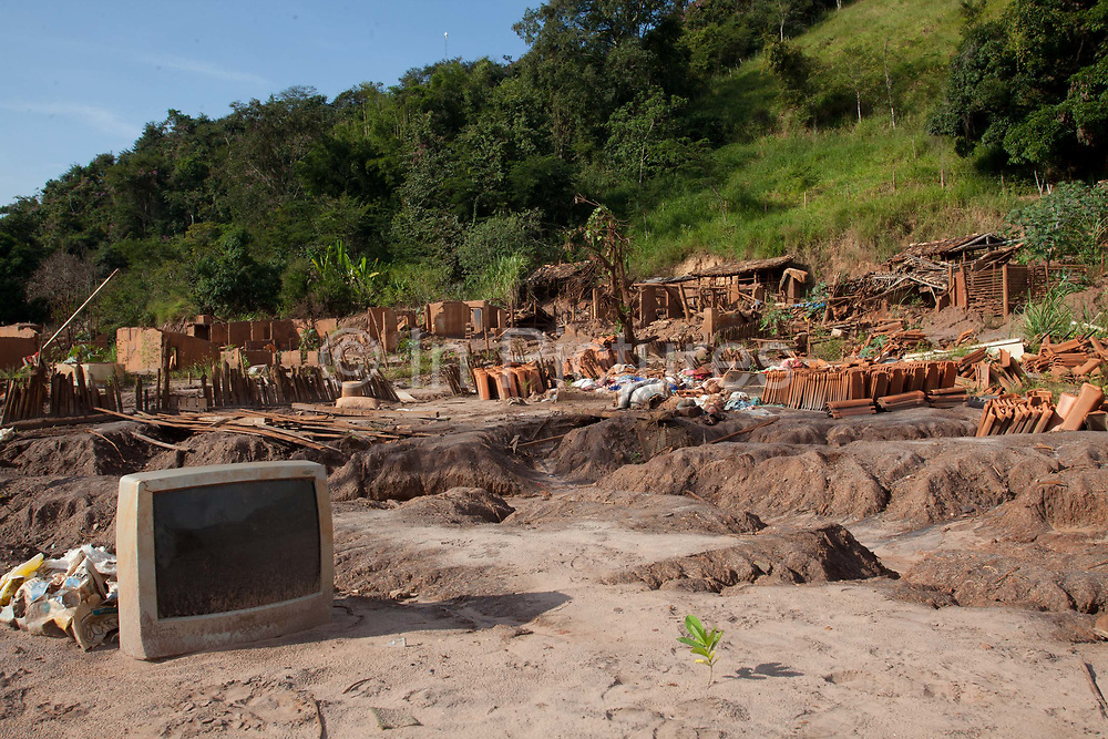 The remains of the village of Paracatu de Baixo. In Nov 2015, the worst environmental disaster in Brazils history happened, when an iron tailings dam owned by the company Sanmarco - a joint project between Brazilian company Vale and British company BHP Biliton, in the municipality of Mariana burst, creating a stream of mud that reached the coast 17 days later, an estimated 60 millions cubic metres of iron ore waste flowed into the Rio Doce river, killed at least 18 people. Minas Gerais, Brazil.