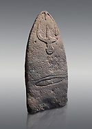 Late European Neolithic prehistoric Menhir standing stone with carvings on its face side. The representation of a stylalised male figure starts at the top with a long nose from which 2 eyebrows arch around the top of the stone. below this is a carving of a falling figure with head at the bottom and 2 curved arms encircling a body above. at the bottom is a carving of a dagger running horizontally across the menhir. Excavated from Genna Arrele II. Menhir Museum, Museo della Statuaria Prehistorica in Sardegna, Museum of Prehoistoric Sardinian Statues, Palazzo Aymerich, Laconi, Sardinia, Italy. Grey background. .<br /> <br /> Visit our PREHISTORIC PLACES PHOTO COLLECTIONS for more photos to download or buy as prints https://funkystock.photoshelter.com/gallery-collection/Prehistoric-Neolithic-Sites-Art-Artefacts-Pictures-Photos/C0000tfxw63zrUT4