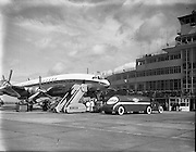 26/04/1958 <br /> 04/26/1958<br /> 26 April 1958<br /> Arrival of Seaboard Super Constellation due to begin Aer Lingus' first transatlantic service two days later. Image shows the aircraft on the runway at in front of the terminal building at Dublin Airport. The aircraft is being refielled by an Esso fuel tanker.
