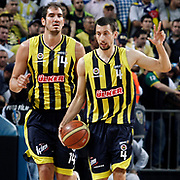Fenerbahce's Roko Leni UKIC (R) and Kaya PEKER (L) during their Turkish Basketball Legague Play-Off final fifth match Fenerbahce between Galatasaray at the Sinan Erdem Arena in Istanbul Turkey on Tuesday 14 June 2011. Photo by TURKPIX