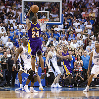09 June 2009: Kobe Bryant of the Los Angeles Lakers takes a jumpshot over Mickael Pietrus of the Orlando Magic as coach Phil Jackson watches during game 3 of the 2009 NBA Finals won 108-104 by the Orlando Magic over the Los Angeles Lakers at Amway Arena, in Orlando, Florida, USA.