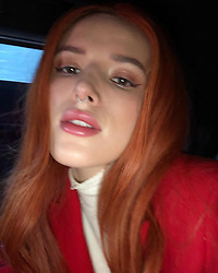 """Bella Thorne releases a photo on Instagram with the following caption: """"iPhone front cam flash w no fixes \ud83d\ude0d DSL ON MY LIPS @thornebybella"""". Photo Credit: Instagram *** No USA Distribution *** For Editorial Use Only *** Not to be Published in Books or Photo Books ***  Please note: Fees charged by the agency are for the agency's services only, and do not, nor are they intended to, convey to the user any ownership of Copyright or License in the material. The agency does not claim any ownership including but not limited to Copyright or License in the attached material. By publishing this material you expressly agree to indemnify and to hold the agency and its directors, shareholders and employees harmless from any loss, claims, damages, demands, expenses (including legal fees), or any causes of action or allegation against the agency arising out of or connected in any way with publication of the material."""