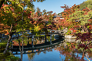 "Fall foliage colors reflect in Hojo Pond at Eikando (formally known as Zenrinji Temple), in Kyoto, Japan. Eikando belongs to the Jodo sect of Japanese Buddhism. It is found just north of the large temple complex of Nanzenji. A court noble of the Heian Period (710-1185) donated his villa to a priest, who converted it into a temple named Zenrinji (""temple in a calm grove""). At its founding, Zenrinji was part of the Shingon sect. In the 11th century, Zenrinji had a popular head priest named Eikan, after whom the temple is popularly named Eikando (""Eikan Hall"")."