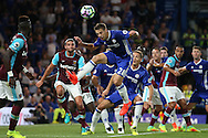 Cesar Azpilicueta of Chelsea jumps to head the ball from a cross. Premier league match, Chelsea v West Ham United at Stamford Bridge in London on Monday 15th August 2016.<br /> pic by John Patrick Fletcher, Andrew Orchard sports photography.