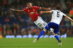 12th September 2017 - UEFA Champions League - Group A - Manchester United v FC Basel - Anthony Martial of Man Utd dives theatrically over the challenge from Michael Lang of Basel - Photo: Simon Stacpoole / Offside.