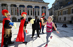 A competitor passes the Guildhall Art Gallery during the 2019 London Landmarks Half Marathon.