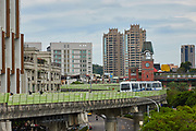 Driverless trains pass each other on the elevated Wenhu line, commonly known as the Brown Line. The line connects Wenshan and Neihu districts in the south and north of the city, and has a total of 24 stations. As a medium capacity line, it sees 180 000 passengers daily.