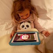 SAN GIMIGNANO, ITALY - OCTOBER 25: A three year old girl playing on an iPad in a hotel room during her vacation. San Gimignano, Tuscany, Italy. 25th October 2017. Photo by Tim Clayton/Corbis via Getty Images)