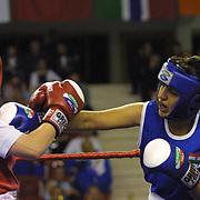 2. WOMEN'S WORLD BOXING CHAMPIONSHIPS.<br /> Denmark's Bettina Karlsen (C) semi final  winner. Bettina (L)  between India's Kaur Karamjit (R). Dilek Sabanci Sport Hall Antalya/Turkey<br /> Photo by Aykut AKICI/TurkSporFoto