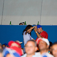 10 january 2006: Fans of Baseball team Licey dance during the game at Estadio Quisqueya, Santo Domingo, Dominican Republic.