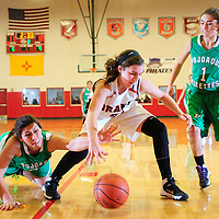 121413  Adron Gardner/Independent<br /> <br /> Pojoaque Elkette Gabby Gonzales (25), left, dives for a steal on Grants Pirate Haley Hall (21) as Elkette Camille Martinez (1) looks on during the Eddie Peña Classic Basketball Tournament in Grants Saturday.