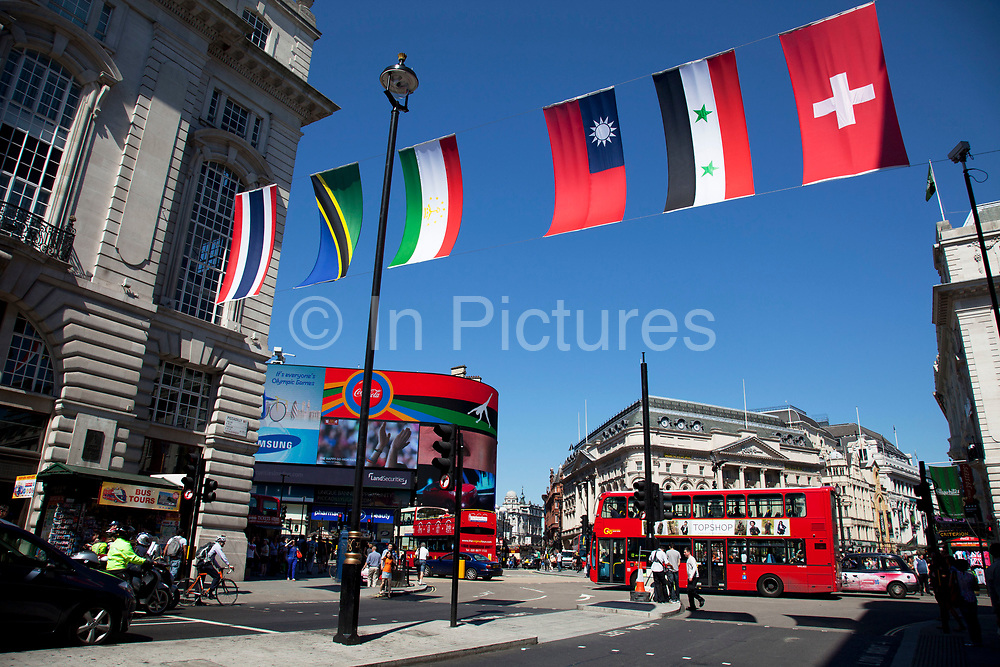 Flags from all nations in the World hang across streets in the West End of London, UK. Here at Piccadilly in celebration of the 2012 Olympic Games, this part of central London is filled with colour.