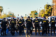 20 MARCH 2012 - PHOENIX, AZ: Phoenix police deploy during a student protest in support of the DREAM Act on 75th Ave in front of Trevor G. Browne High School Tuesday.  PHOTO BY JACK KURTZ