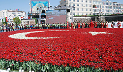 April 18, 2018 - Kayseri, Türkiye - Kayseri Metropolitan Municipality broke a record with 168 thousand tulips and 400 square meters of the world's largest Turkish-flag-based tulip landscaping. Metropolitan Municipality, which added beauty of the city with flowers, especially lilies, made a remarkable work in this area. Starting from yesterday evening 11:00 am, works continued till morning to make the world's largest  Turkish flag was performed. (Credit Image: © Depo Photos via ZUMA Wire)