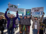 "15 MARCH 2019 - ST. PAUL, MINNESOTA, USA: Students hold up signs during the MN Youth for Climate Justice ""Climate Strike"" at the Minnesota State Capitol in St. Paul, MN. Thousands of high school students braved below freezing temperatures and biting winds to demand action on climate change. The Minnesota Climate Strike was inspired by the strike by Greta Thunberg, a Swedish high school student, who started a climate strike at her school in August 2018.        PHOTO BY JACK KURTZ"