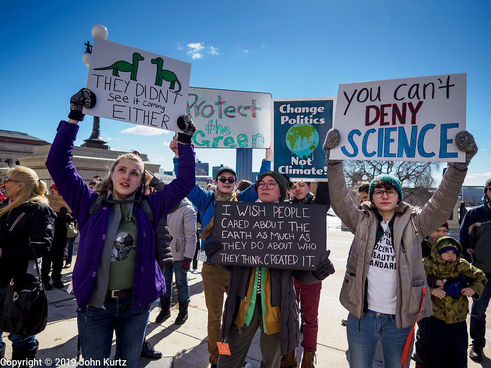 """15 MARCH 2019 - ST. PAUL, MINNESOTA, USA: Students hold up signs during the MN Youth for Climate Justice """"Climate Strike"""" at the Minnesota State Capitol in St. Paul, MN. Thousands of high school students braved below freezing temperatures and biting winds to demand action on climate change. The Minnesota Climate Strike was inspired by the strike by Greta Thunberg, a Swedish high school student, who started a climate strike at her school in August 2018.        PHOTO BY JACK KURTZ"""