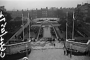 11/04/1966<br /> 04/11/1966<br /> 11 April 1966<br /> 1916 Jubilee Commemorations- Opening and Blessing Ceremony at the Garden of Remembrance, Parnell Square, Dublin. Image shows part of the blessing service and the whole of the garden. In left foreground is a television crew.