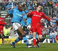 Photo Aidan Ellis.<br />Manchester City v Middlesboro (FA Barclaycard Premiership) 12/04/2003.<br />City's Nicolas Anelka and Boro's Malcolm Christie