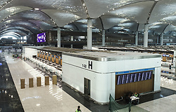 Exclusive - The first phase of Istanbul's new airport is due to open in October 2018, and once it is complete, it is expected to become the world's busiest airport. Istanbul New Airport will be constructed over an area of 76.5 million square meters to the north of İstanbul, 35km away from the city centre. The construction will be carried out in four phases, and the first is scheduled to open on 29 October, Turkey's Republic Day. It will comprise of three runways and a terminal with a capacity for 90 million passengers. Once complete, the new airport will have six runways and will host flights going to more than 300 destinations. It will have an annual passenger capacity of up to 200 million people, making it the world's busiest airport. Photo by Tolga Adanali/Depo Photos/ABACAPRESS.COM