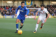 AFC Wimbledon attacker Harry Forrester (11) dribbling during the EFL Sky Bet League 1 match between AFC Wimbledon and Walsall at the Cherry Red Records Stadium, Kingston, England on 25 November 2017. Photo by Matthew Redman.