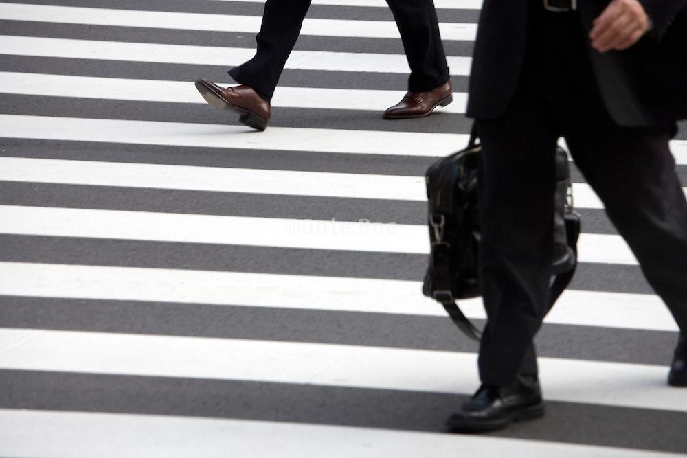 detail of businesspeople on a pedestrian crossing Tokyo Japan