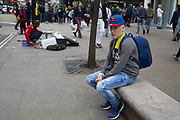 Young man wearing a Superman baseball cap while out on Oxford Street in London, United Kingdom.