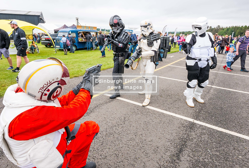 Pictured: Scotland's National Airshow, East Fortune, East Lothian, Scotland, United Kingdom, 27 July 2019 . A packed programme of aircraft old and new planned to take to the skies for the aerial display was marred by poor weather at airfields around the country which meant that many of the promised flights were unable to perform. Stormtroopers entertain the crowd.<br /> Sally Anderson   EdinburghElitemedia.co.uk