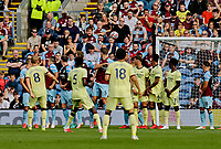 Football - 2021 / 2022 Premier League - Burnley vs. Arsenal<br /> <br /> Martin Odegaard of Arsenal curls a free kick around the Burnley wall to put his team 1-0 ahead in the first half, at Turf Moor.<br /> <br /> <br /> COLORSPORT/ALAN MARTIN