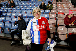 A fan wears a half-and-half shirt before the Premier League match at the John Smith's Stadium, Huddersfield.