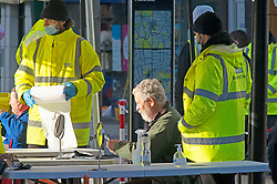 © Licensed to London News Pictures 07/01/2021.         Bexleyheath, UK. Staff helping people to self test. A Coronavirus self testing site has been set up on the Broadway in Bexleyheath, South East London. An estimated one in 30 people in London were infected with Covid-19 between December 27th and January the 2nd. Photo credit:Grant Falvey/LNP