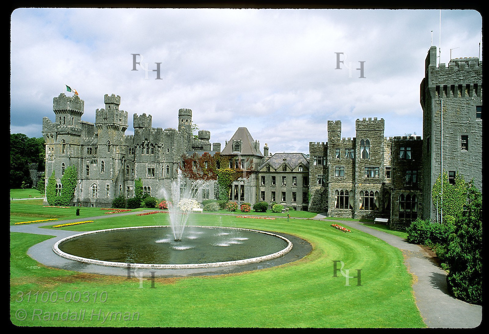 Fountain and greens grace grounds of 83-room Ashford Castle, one of Ireland's finest hotels; Cong Ireland