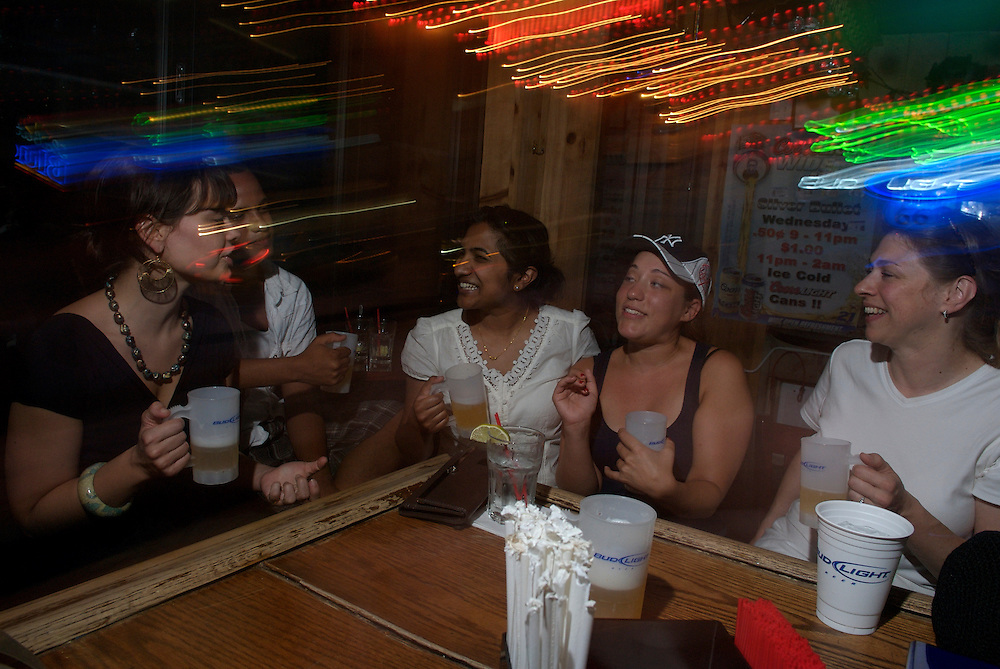 Locals travel to Bourbon Street Bar on the Upper West side of Manhattan for 50 cent drink specials on Coors Light and Bud Light Draft beers Wednesday, Thursday and Friday Evenings...(L-R) Caitlin Kundrat, 23 from Queens, Alexis Francisco, 22 from the Bronx, Amy Mundackal, 23 from New Rochelle, New York, Samantha Cambelle, 22 from South Hampton, and Nancy Brown from New Rochelle enjoy a few beers together..Photos by Tiffany L. Clark