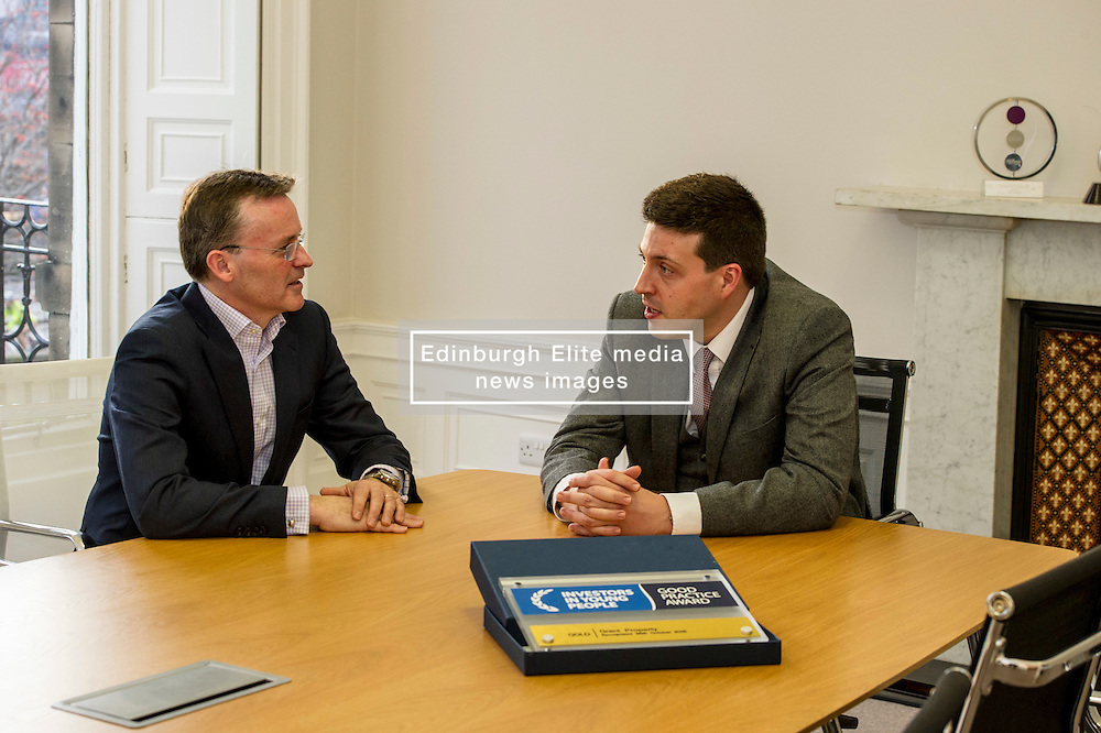 Pictured: Jamie Hepburn and John Moran, managing director Grant Properties<br /> <br /> Employability and training minister Jamie Hepburn MSP, visited Grant Property in Edinburgh today to announce the latest labour market statistics and to award the company the 350th Investors in Young People award. <br /> <br /> Ger Harley | EEm 14 December 2016