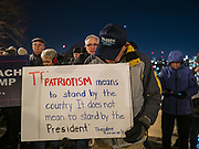 17 DECEMBER 2019 - DES MOINES, IOWA: CARL SCHUMANN, from Beaverdale, IA, a supporter of Senator Elizabeth Warren, with a sign calling for the impeachment of President Donald Trump. About 300 people came to the Iowa State Capitol in Des Moines in near freezing weather Tuesday evening to call for Trump's impeachment. The rally, and others like it around the US, come on the eve of an impeachment vote in the US House of Representatives.     PHOTO BY JACK KURTZ
