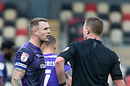 Tranmere Rover's Peter Clarke (26) has words with referee Thomas Bramall during the EFL Sky Bet League 2 match between Newport County and Tranmere Rovers at Rodney Parade, Newport, Wales on 17 October 2020.